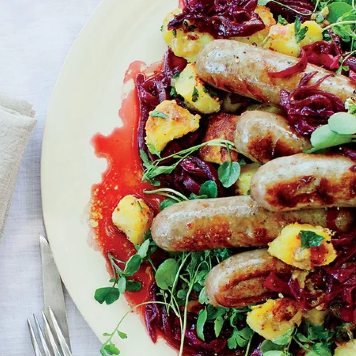 Bratwurst_with_mustardy_fried_potatoes_and_braised_cabbage.jpg
