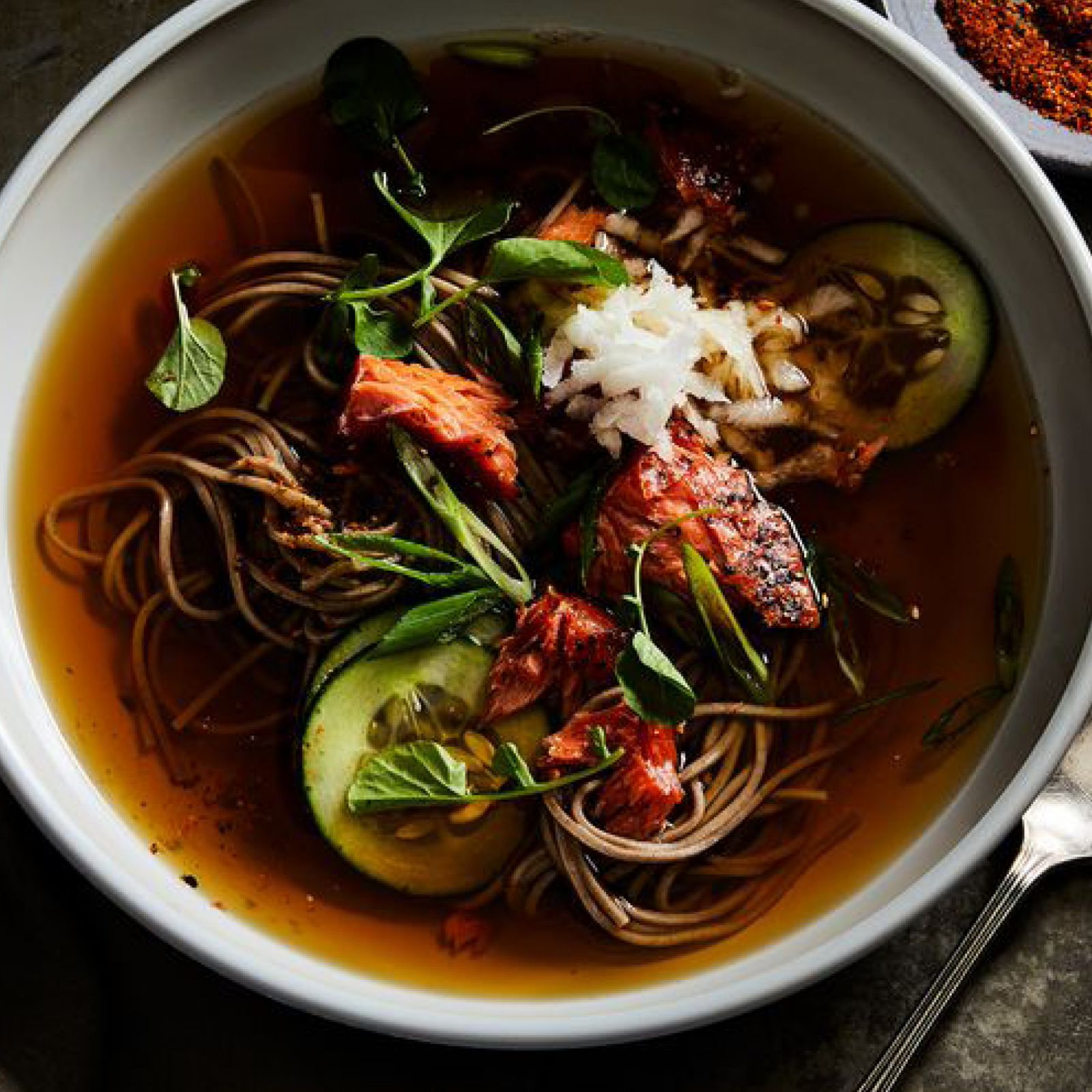 Hot_soba_noodle_soup_with_salmoncucumber_and_tagarashi.jpg