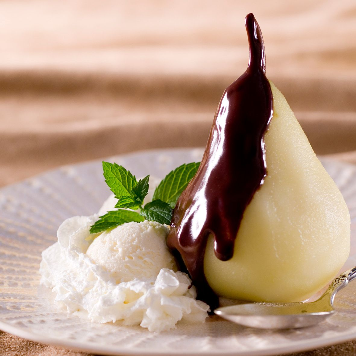 Poached pear with chocolate sauce.jpg
