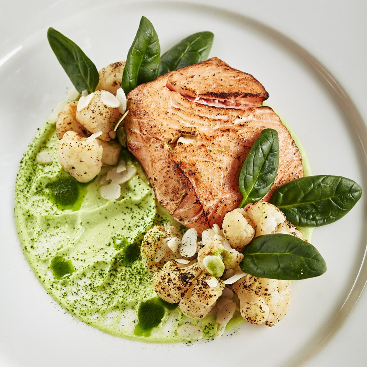 Fillet of salmon with green pea cream and scorched cauliflower.jpg