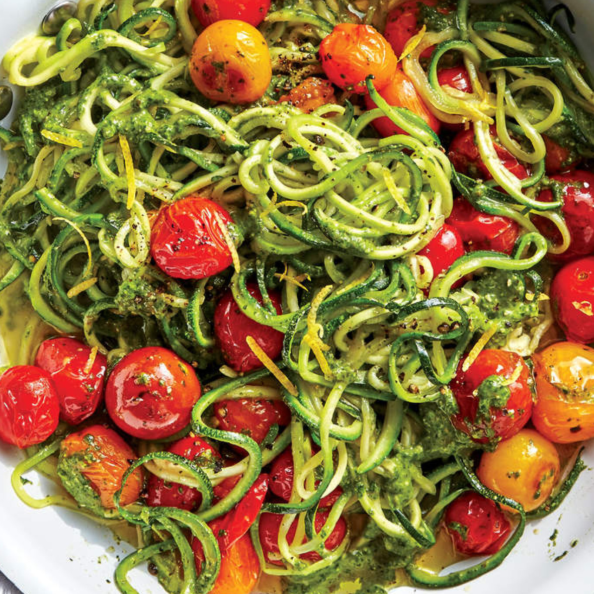zoodles with tomatoes and spinach caper pesto.jpg