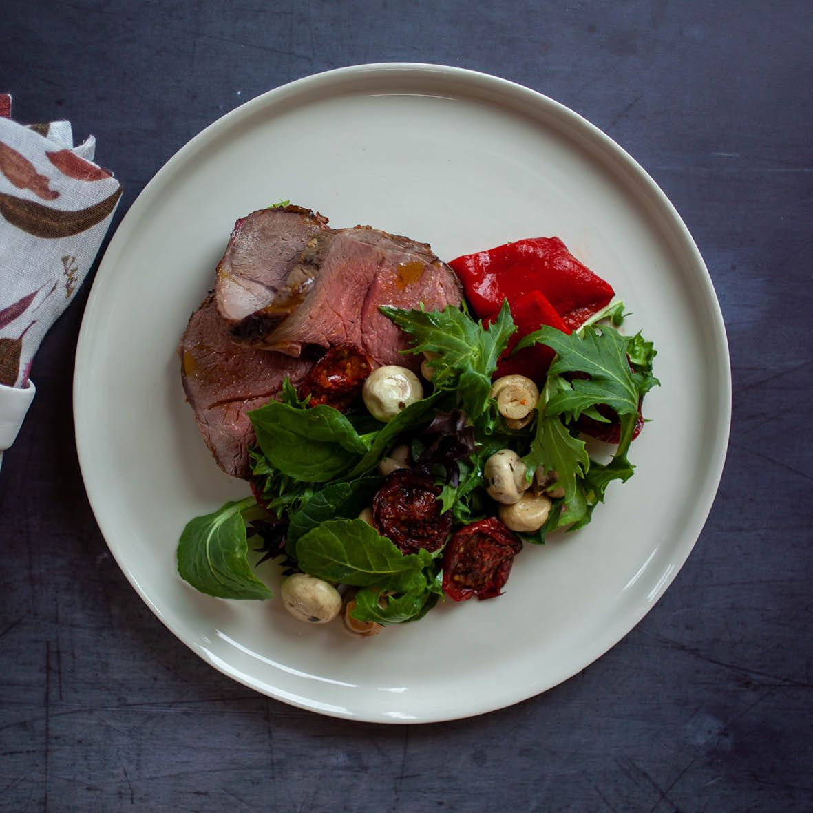 Leg of Lamb with Sumac Roasted Tomato Salad.jpg