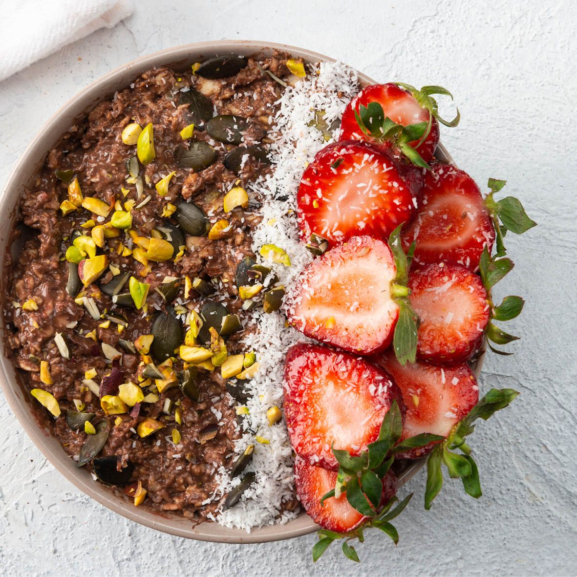 Choc_Coconut_smoothie_bowl_with_Strawberries_and_Pistachios.jpg
