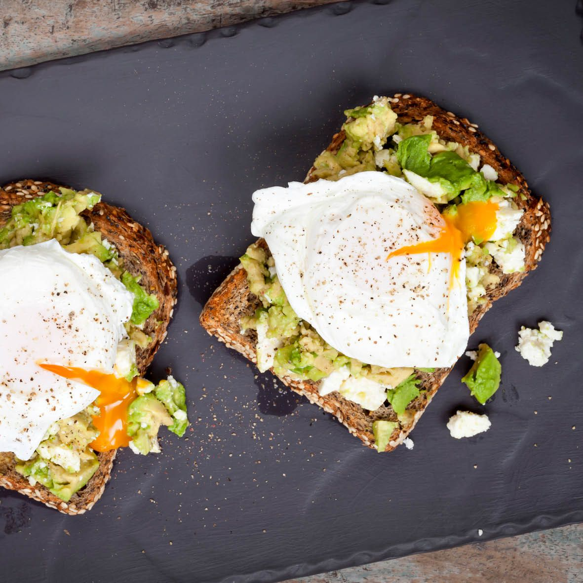 Poached_eggs_avocado_and_feta_toast.jpg